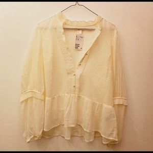HandM ivory button and ruffle blouse. Size 12. New